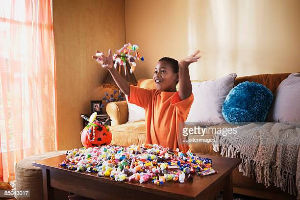 excited boy with halloween candy - halloween candy stock photos and pictures