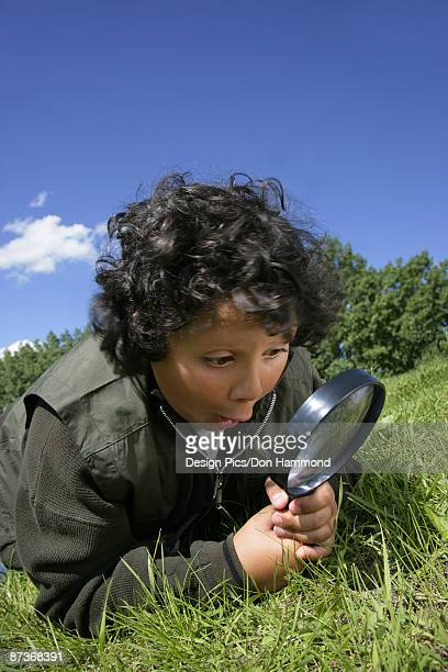 Excited Boy with Magnifying Glass