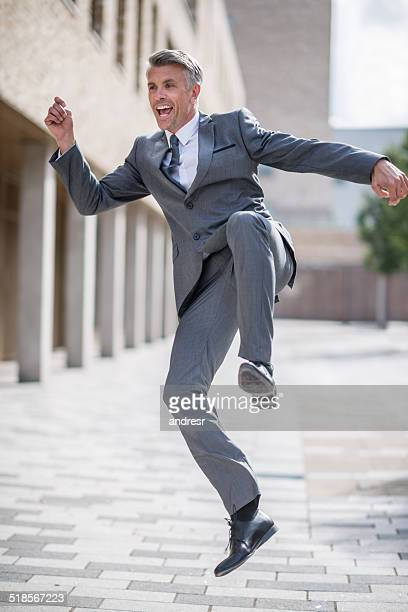 excited business man - skipping along stock photos and pictures