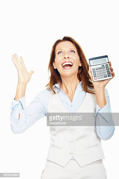Excited business woman holding a calculator