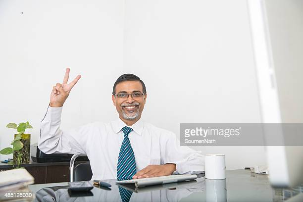 Excited Businessman Giving the Thumbs Up