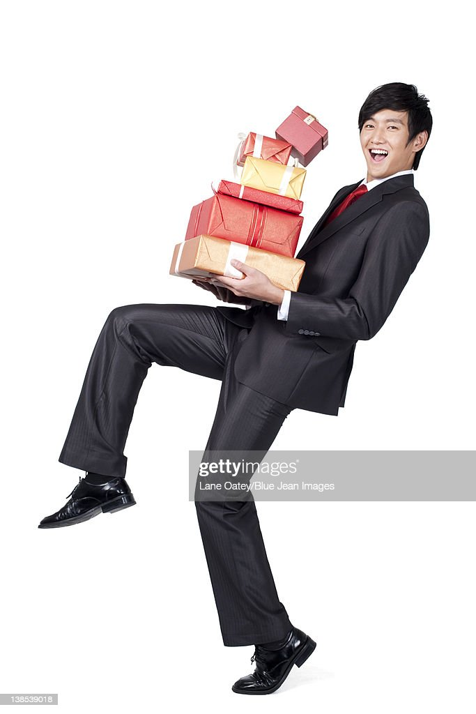 Excited Businessman Holding A Stack Of Gifts High-Res ...
