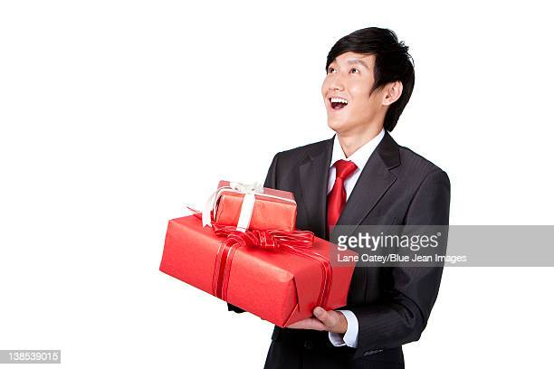 Excited Businessman Holding Gifts