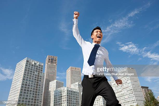 excited businessman jumping - 22 jump street fotografías e imágenes de stock