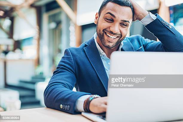 excited businessman - using computer stock photos and pictures