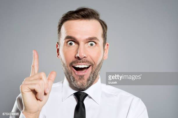 Excited businessman staring at the camera, studio shot