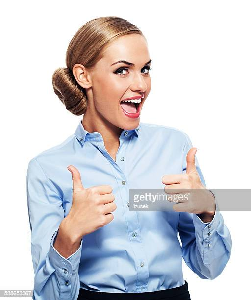 Excited businesswoman with thumbs up