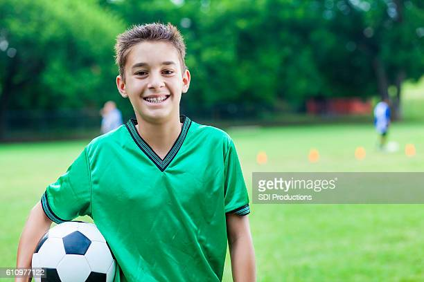 Excited Caucasian male soccer player at his game
