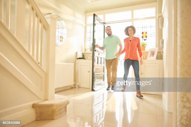 excited couple entering a rental property