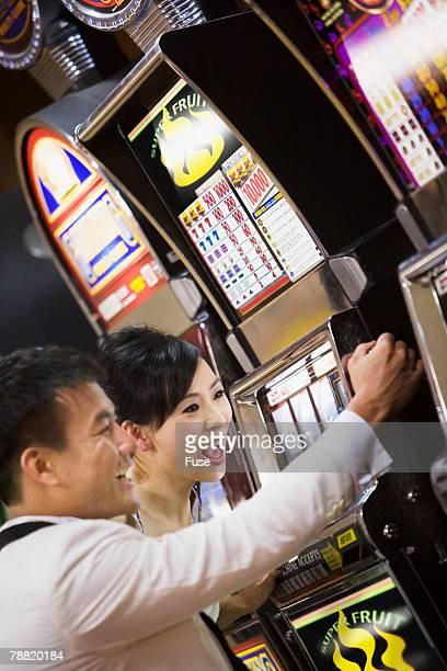 Excited Couple Gambling on Slot Machine