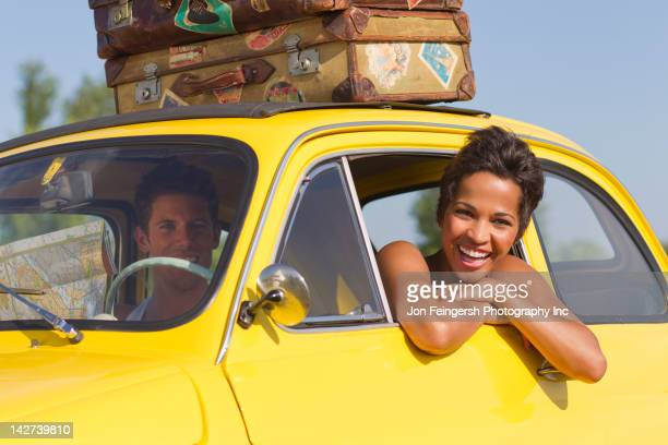 Excited couple on road trip