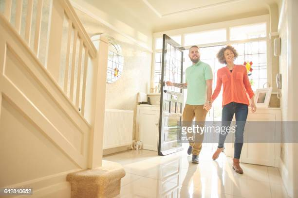 excited couple with keys to new home - house key stock photos and pictures