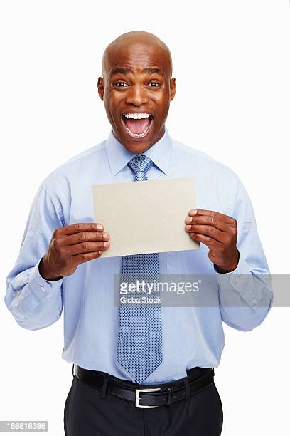 Excited executive showing a card