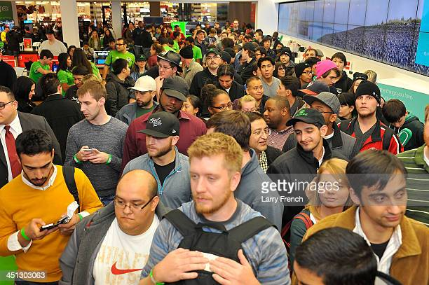 Excited fans anxiously wait to pick up their new Xbox One at the midnight launch event at Tysons Corner Center on November 21, 2013 in McLean,...