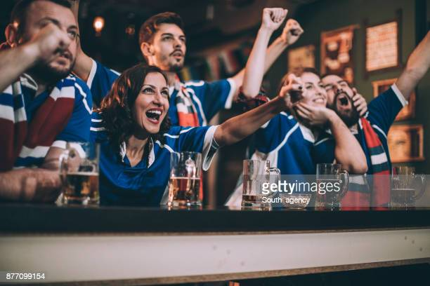 Excited fans at the bar