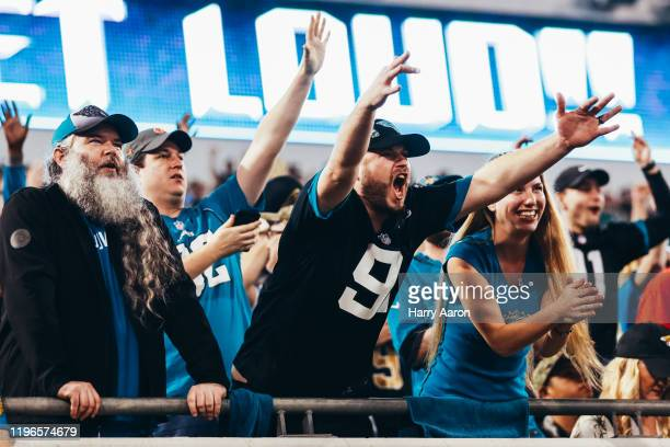 Excited fans of the Jacksonville Jaguars after the team quickly scores backtoback touchdowns against the Indianapolis Colts in the fourth quarter at...