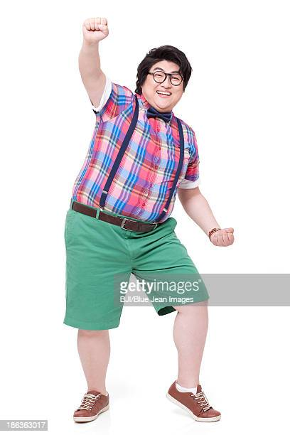 Excited fat man punching the air