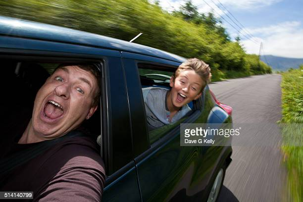 Excited Father & Son Travelling in Car