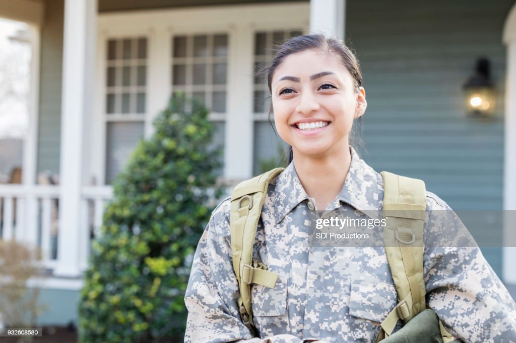 Excited female soldier leaving for deployment : Stock Photo