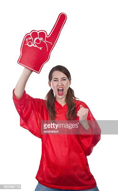 excited female sports fan with foam finger - foam finger stock photos and pictures