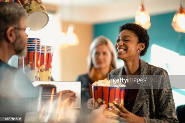 excited for her popcorn - film industry stock pictures, royalty-free photos & images
