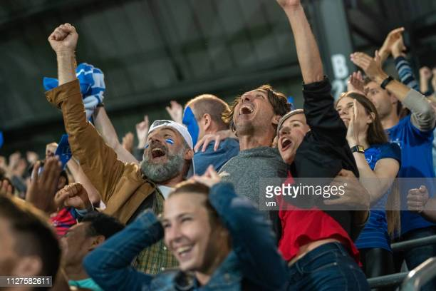 excited friends celebrating success of their team - cheering stock pictures, royalty-free photos & images