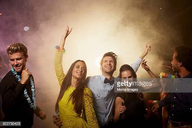 Excited friends enjoying on dance floor