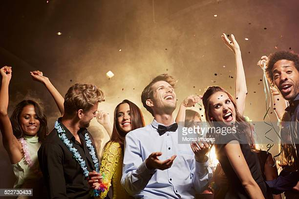 Excited friends enjoying on dance floor
