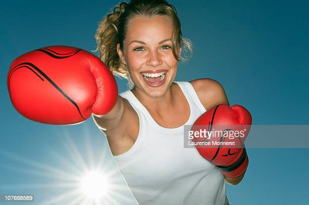 Excited girl front boxing with red gloves