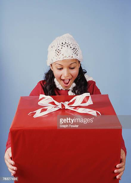 Excited girl holding present