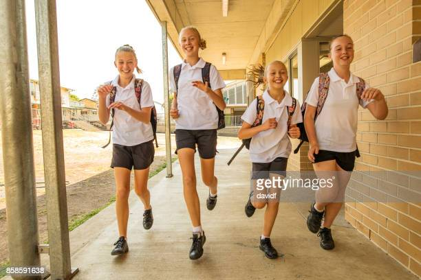 Excited Girl Junior High School Students Running at School