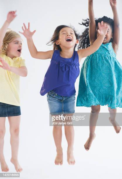 Excited girls jumping together