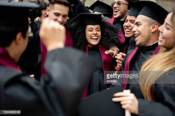 excited group of students celebrating their graduation - alumni stock pictures, royalty-free photos & images