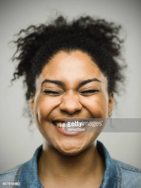 excited happy afro american woman against gray background - clenching teeth stock pictures, royalty-free photos & images