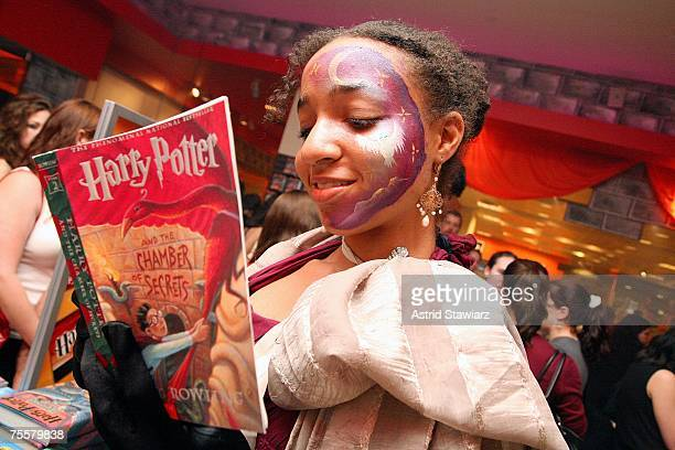 Excited Harry Potter fan Sarah Smith holds a copy of Harry Potter And The Chambers of Secrets at Borders inside the Time Warner Center to celebrate...