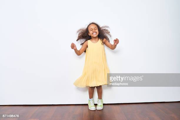 excited little girl dancing - little russian girls stock photos and pictures