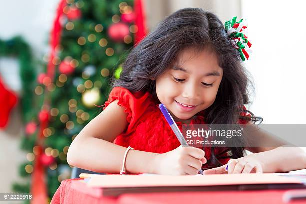 Excited little girl makes homemade Christmas card