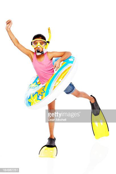 Excited little girl wearing snorkel equipment