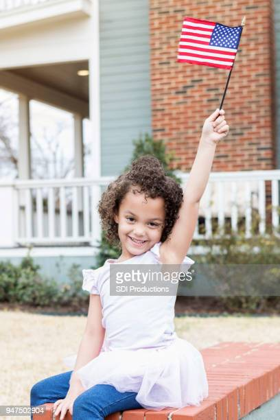 excited little girl with american flag - flag day stock pictures, royalty-free photos & images