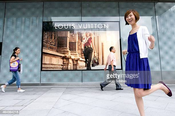 Excited Liu Yi in front of a Louis Vuitton store part of Plaza 66 shopping mall on September 15 2009 in Shanghai China