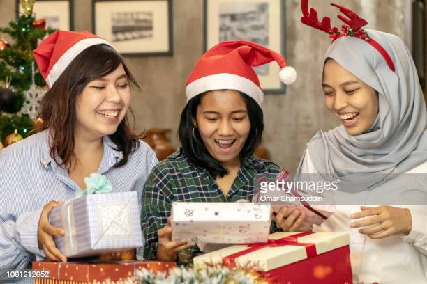 Excited looking at Christmas presents