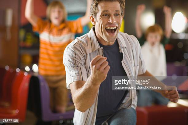 Excited man at bowling alley