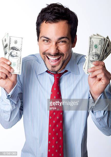 excited man holding hundred dollar bills in both hands