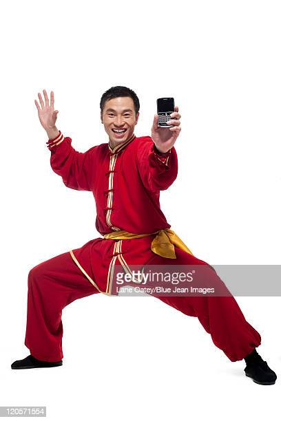 Excited Man In Traditional Chinese Clothing Holding Up a Mobile Phone