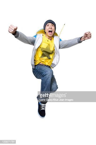 Excited man jumping up