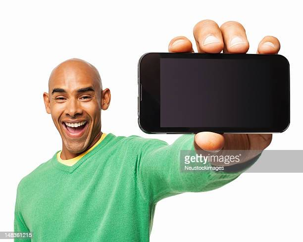 excited man showing smart phone - isolated - tonen stockfoto's en -beelden