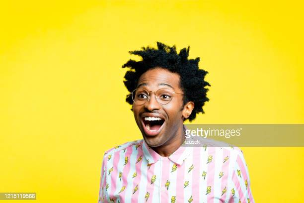excited man wearing vintage shirt, portrait on yellow background - african ethnicity stock pictures, royalty-free photos & images