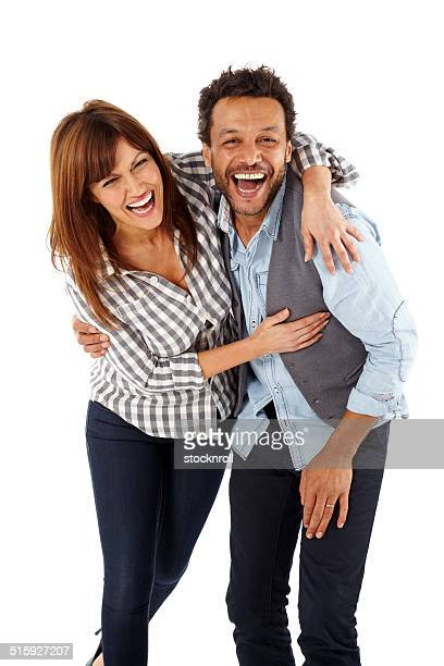 Excited mature couple together laughing