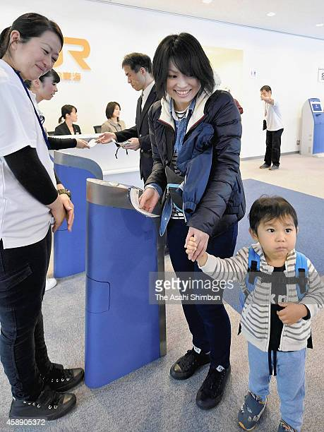Excited members of the public check in for a test run of a maglev Shinkansen on November 13 2014 in Tsuru Yamanashi Japan One hundred railway fans...