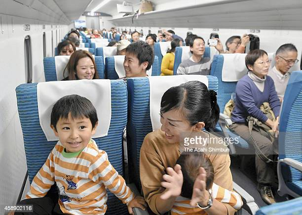 Excited members of the public take a ride on a maglev Shinkansen on November 13 2014 in Tsuru Yamanashi Japan One hundred railway fans turned out for...